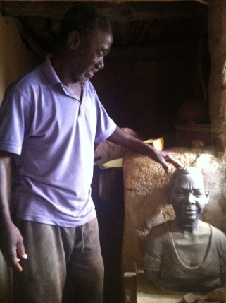 Chris Azaare with a sculpture of his mother